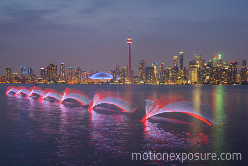 Motion Exposure: Adam van Koeverden &emdash; Toronto - Av Red and White Kayak